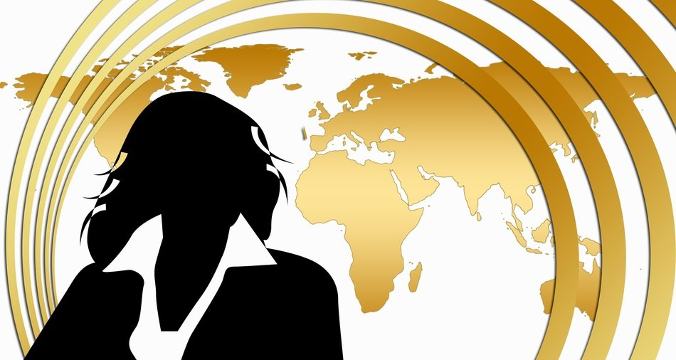 clipart of the businesswoman sillhouette and world map