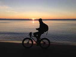 Picture of riding on a bike man on a beach