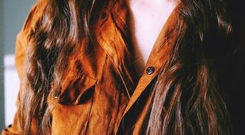 brown suede blouse on a woman
