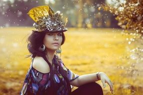 woman in flowered hat with bared shoulders, beauty queen