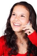 smiling young girl calling mobile phone