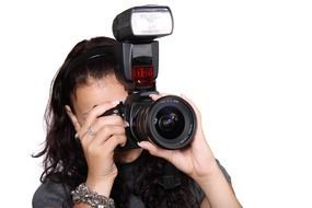 female holding digital camera equipment