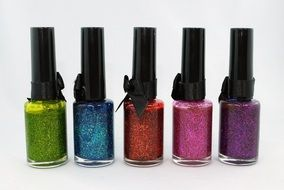 colorful nail polish with glitters