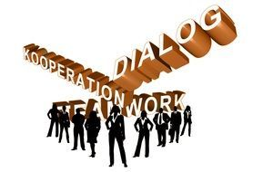 "silhouettes of business people on the background of inscriptions ""dialogue"", ""cooperation"", ""teamwork"""