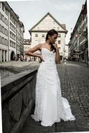 woman in white wedding dresses street view