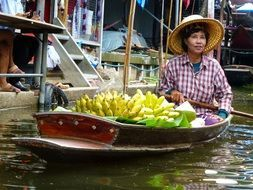woman on boat as vendor in thailand