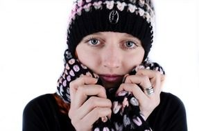 young female model in winter hat and scarf