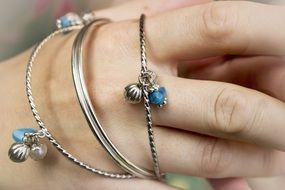 closeup photo of the jewelry on a hand