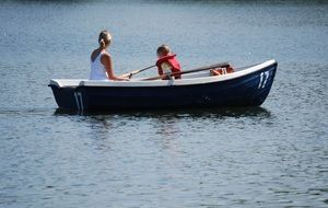 woman and girl on the rowing boat