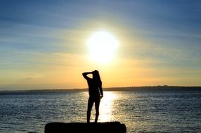 woman silhouette sea sunset scene