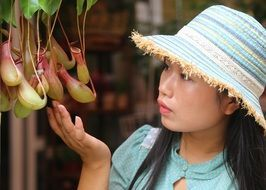 portrait of young asian woman small fresh fruit