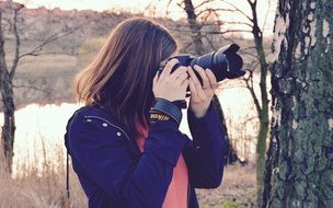 photographer woman making photo in Forest