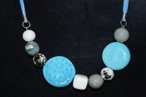 blue gray lady strings of beads