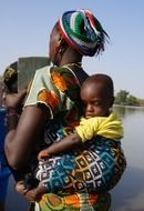 woman child carrying african black