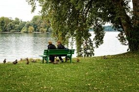 couple on a bench by the lake