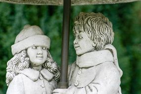 statues of girl and boy on the street