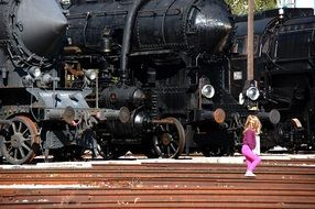 girl watching retro locomotives