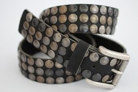 photo of a leather belt with metal rivets