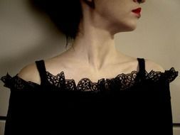 woman with red lips in a black lace dress