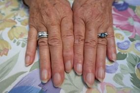 hands of aged woman jewellery finger ring