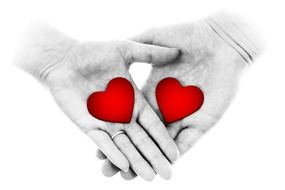 female and male hands with red hearts