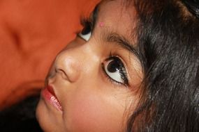 child children face indian girl big brown eyes dark hairs