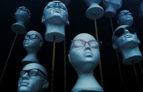 the heads of the mannequins in the glasses