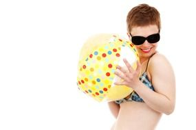 woman in a bikini with a beach ball