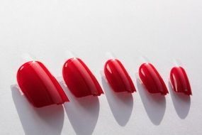 fingernails red lacquered