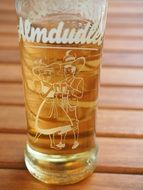 a glass of almdudler lemonade