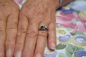 hands of old woman jewellery finger ring