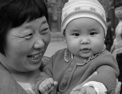 portrait of happy grandmother with baby