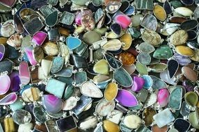 heap of gemstone pendants