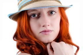 woman with red hair in hat