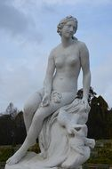 naked woman sculpture in park at evening, germany, potsdam, sanssouci