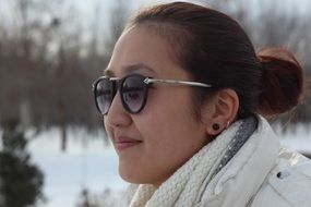 girl in sunglasses on the street in winter