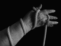 Hand holding a rope
