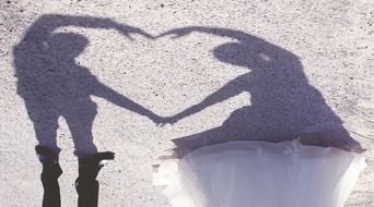 Shadows of wedding couple on a sand