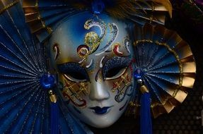 photo of blue carnival mask in venice