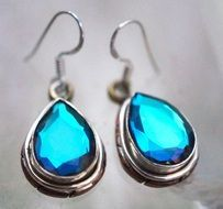 silver earrings with blue gemstone