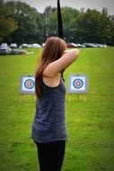 archery woman goal Green field view