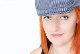 red-haired woman in cap