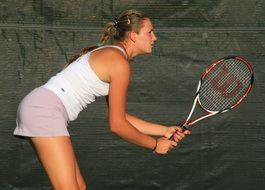 tennis player with a racket in her hand