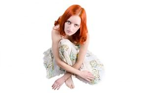 posing red haired woman
