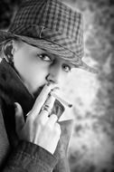 black and white portrait of a smoking woman