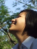 photo of a smiling asian schoolgirl
