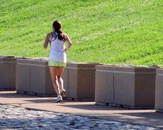 young woman jogging in the sunny morning