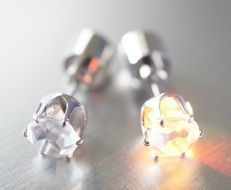 silver earrings with luminous stones