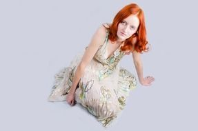 red haired woman in beautiful dress