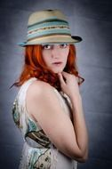 portrait of a red haired woman in hat
